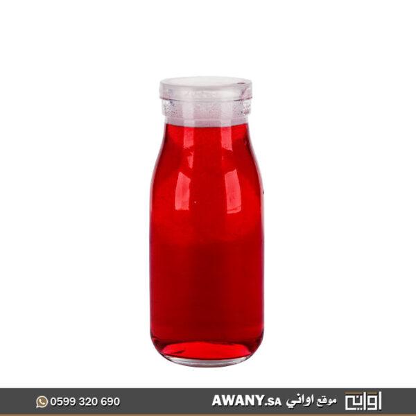 علب عصير أو قوارير زجاجيه